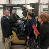 Representative Visiting A Forklift Driver
